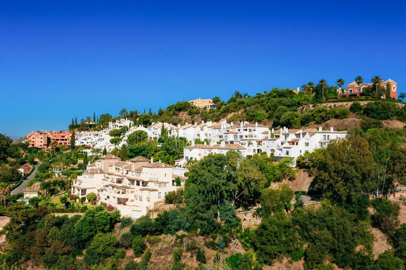 benahavis-malaga-andalusia-spain-summer-cityscape-village-whitewashed-houses-sunny-day-good-weather-clear-blue-71535106